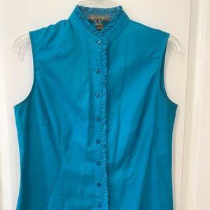 Turquoise button down sleeveless shirt.
